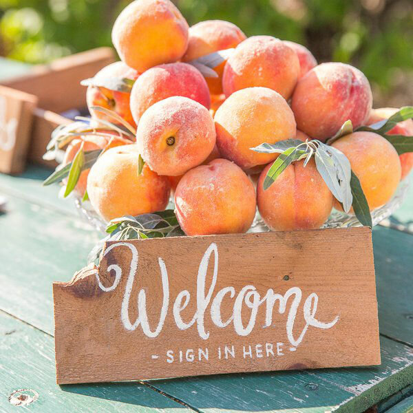 Welcome sign with peaches.